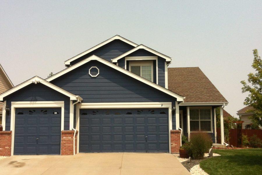 Dark blue house and garage