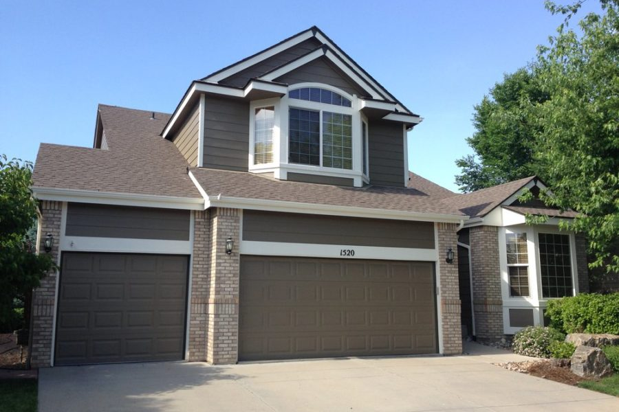 Dark brown and brown brick house with garage